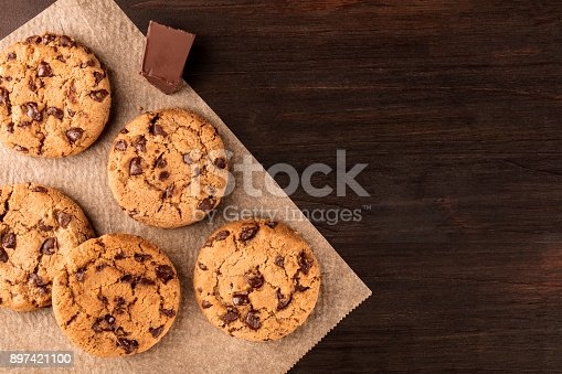 istock Chocolate chips cookies on baking paper with copyspace 897421100
