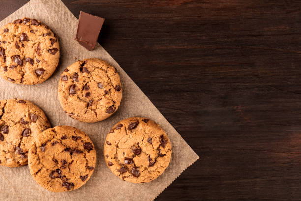 Chocolate chips cookies on baking paper with copyspace stock photo