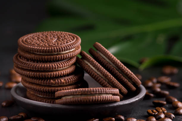 Chocolate chips cookies on black background. stock photo