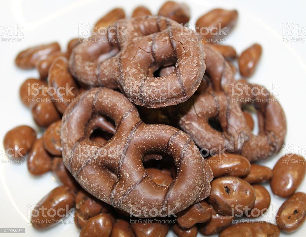 Chocolate coated Pretzels, with chocolate coated raisins. stock photo
