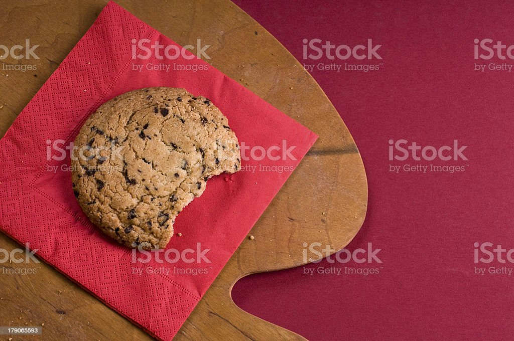 Chocolate cookie over on a cutting board royalty-free stock photo