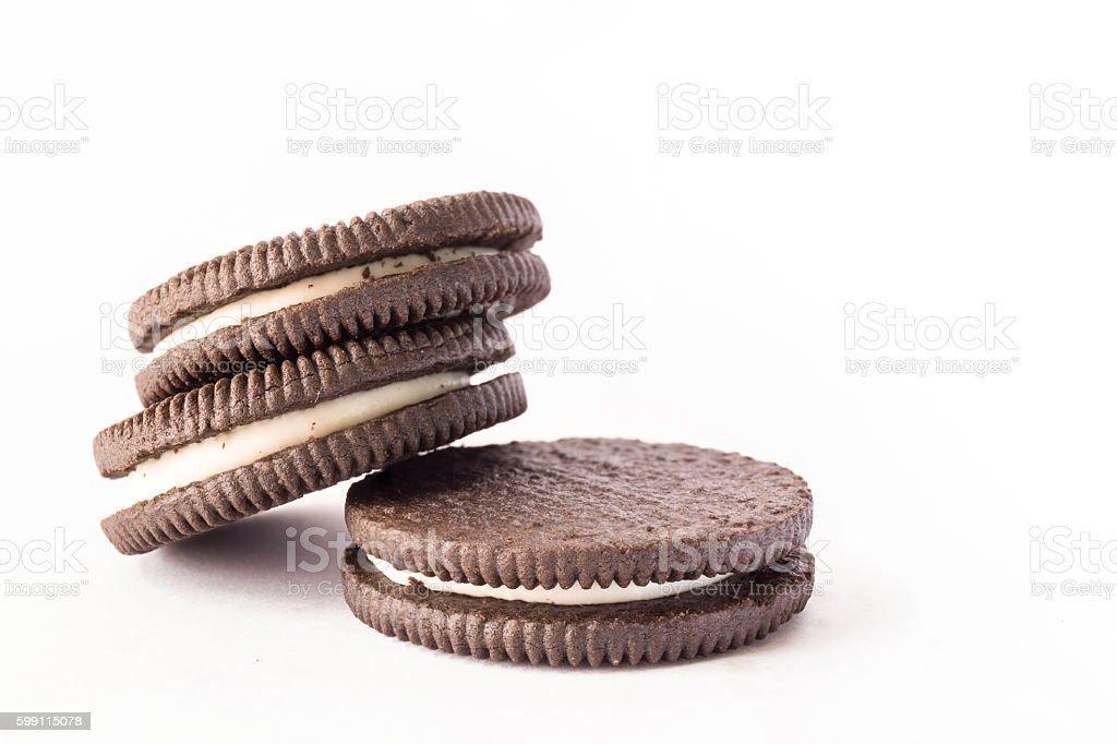 chocolate cookie with milk cream inside stock photo
