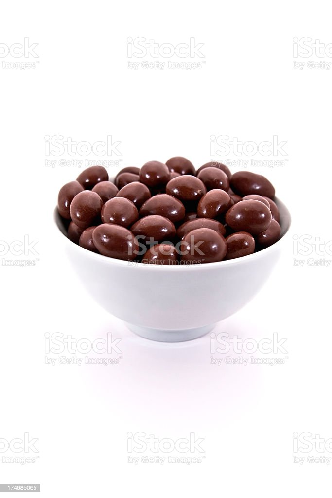Chocolate Covered Almonds in White Bowl royalty-free stock photo