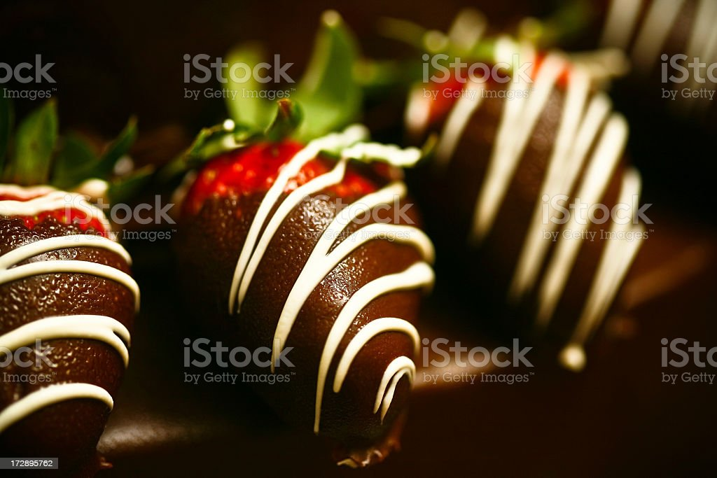 Chocolate covered strawberries with white chocolate drizzle stock photo