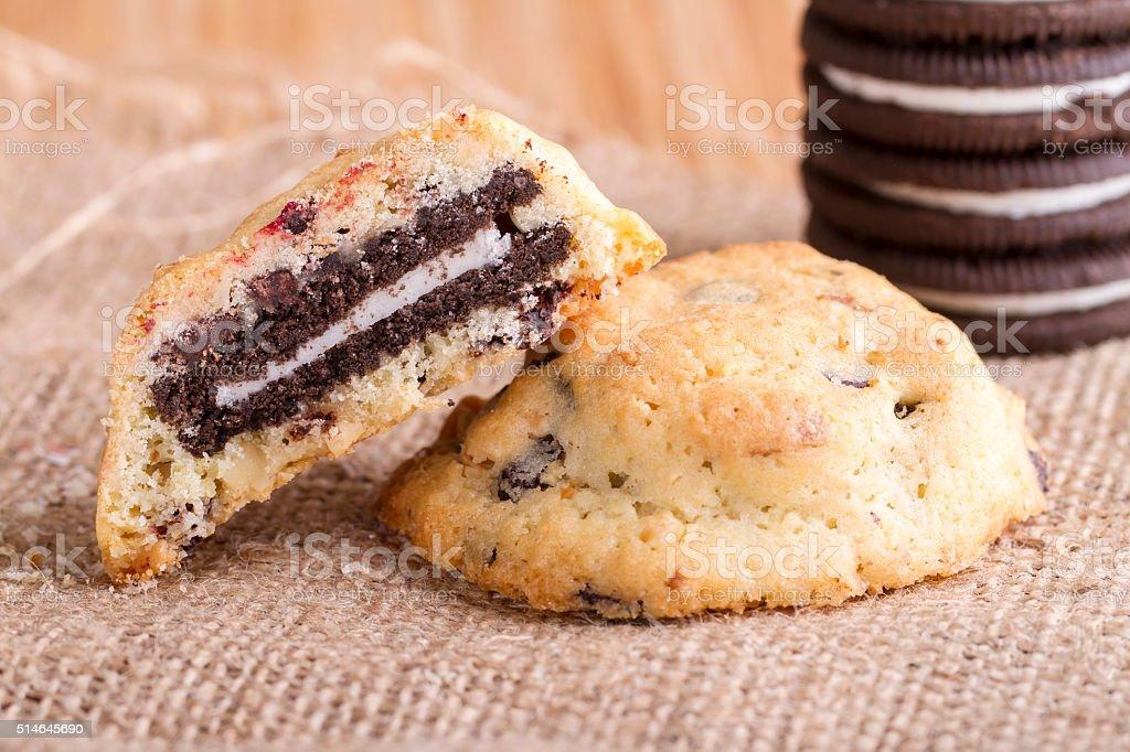Chocolate cream cookies isolated on burlap texture stock photo