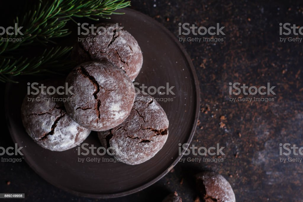 Chocolate crinkle cookies with powdered sugar icing stock photo