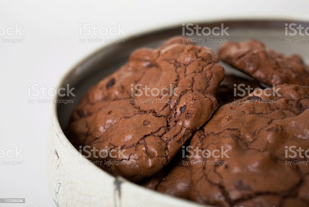 Chocolate crumbled cookies in a tin royalty-free stock photo