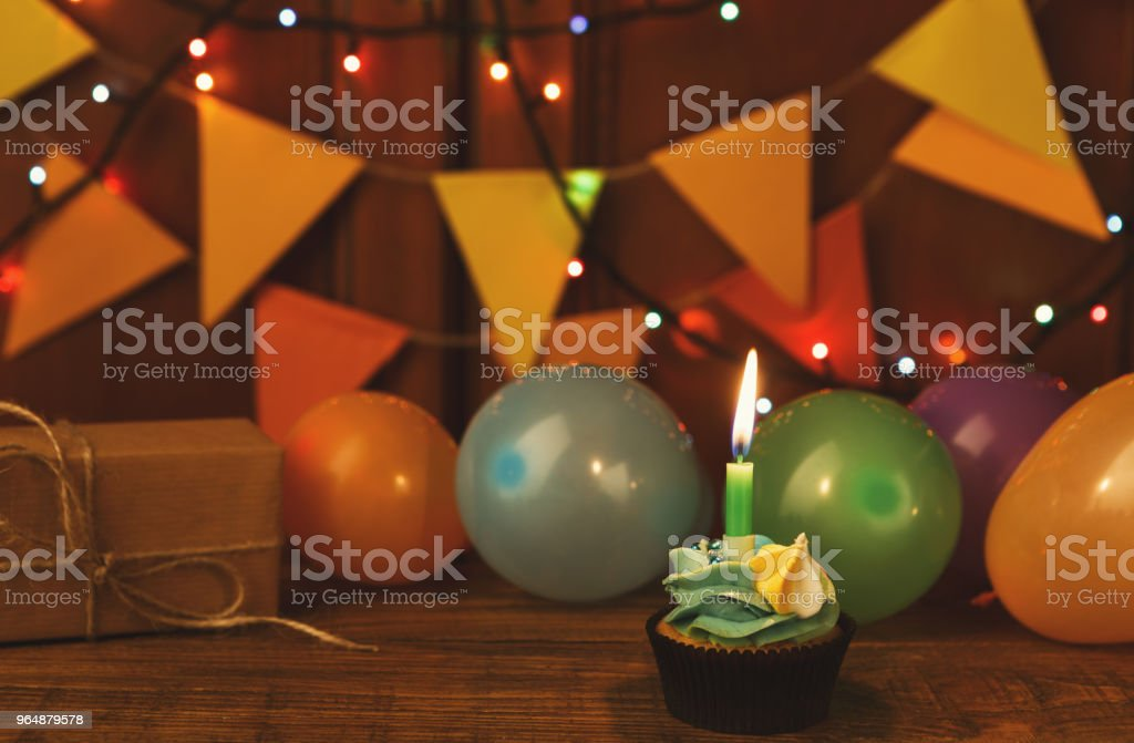 Chocolate cupcake with candle against festive background royalty-free stock photo