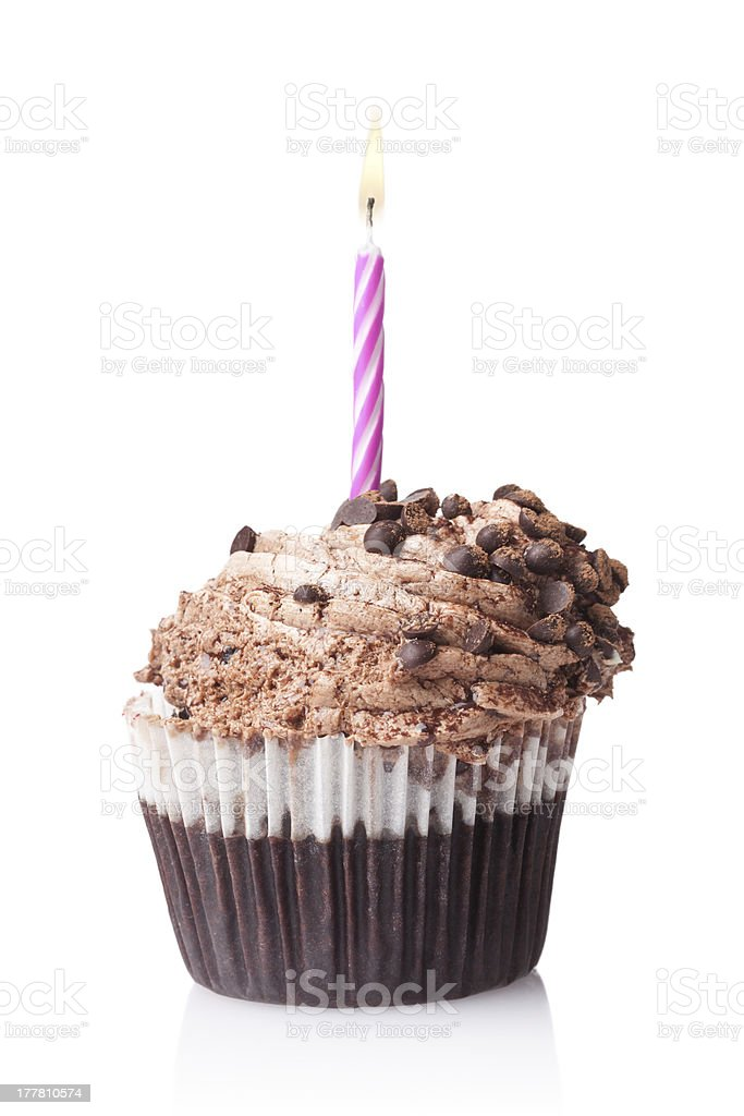 chocolate cupcake with candle isolated on white background royalty-free stock photo
