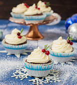 Chocolate cupcake with cream cheese in Christmas decorationsChocolate cupcake with cream cheese in Christmas decorations