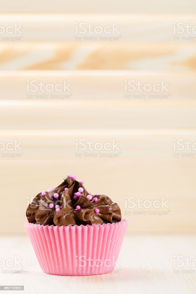 Chocolate cupcake with pink sprinkles stock photo
