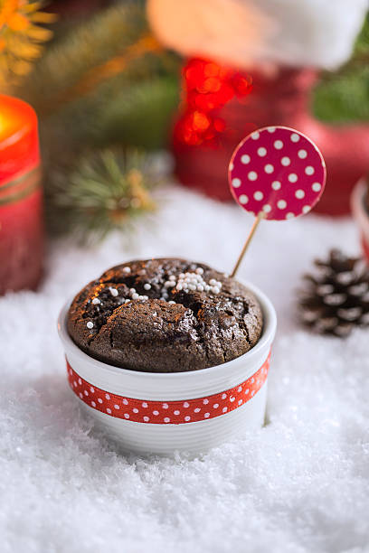 Chocolate Cupcake with Snowflakes, Candle and Christmas Tree stock photo