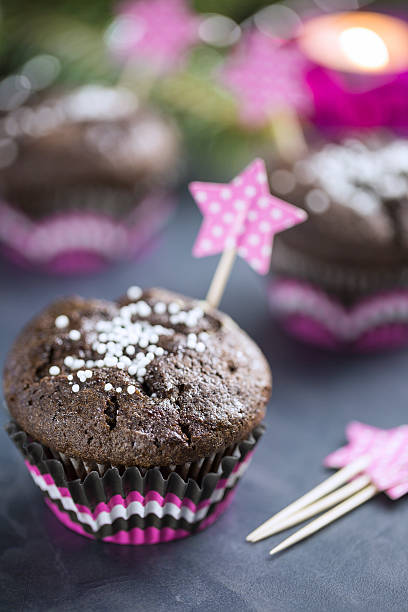 Chocolate Cupcake with Snowflakes in Pink Punnet stock photo