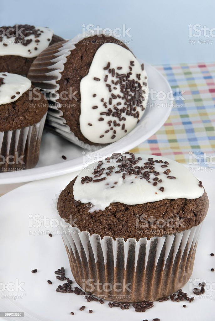 chocolate cupcakes with butter cream icing and chocolate sprinkles royalty-free stock photo