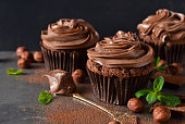 Chocolate cupcakes with peanut paste the old grunge background