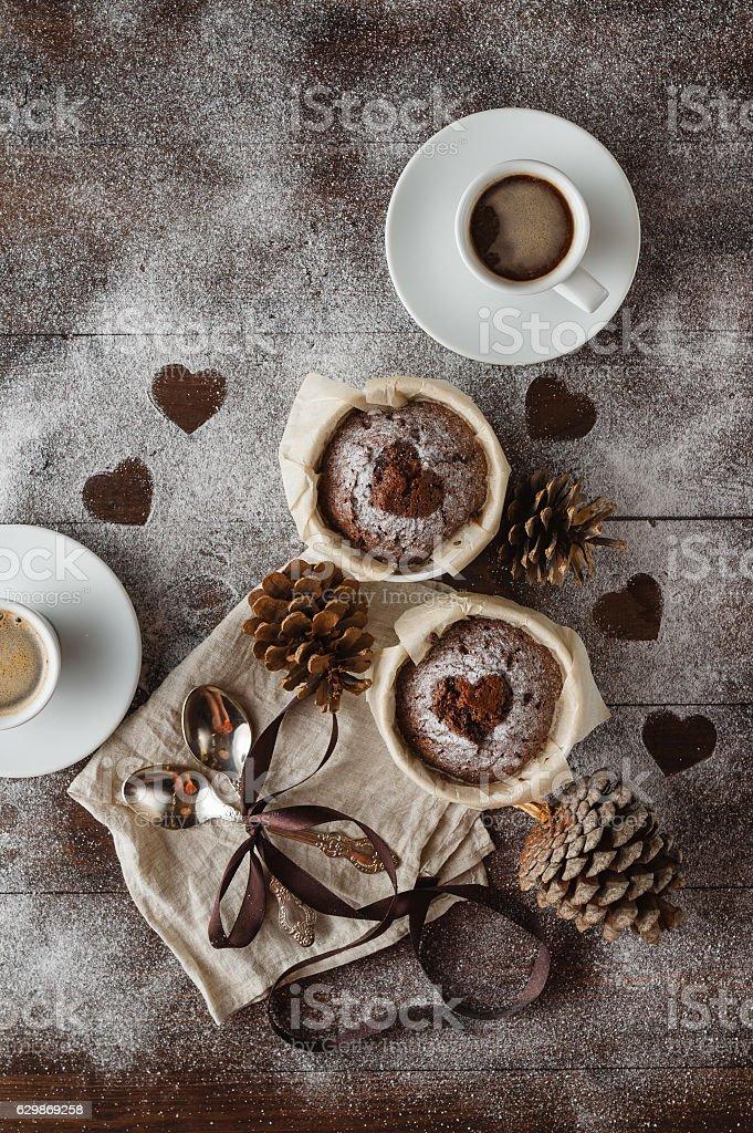 Chocolate Cupcakes with sugar hearts stock photo