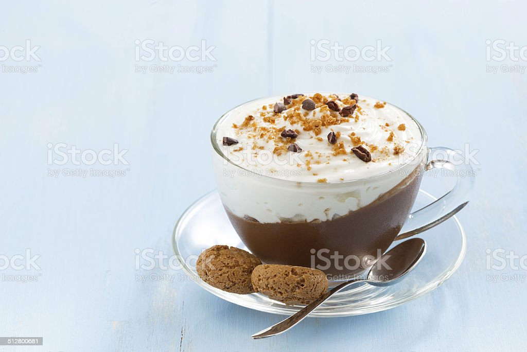 chocolate dessert with cream and amaretti in cup stock photo