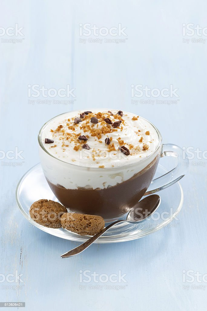 chocolate dessert with cream and amaretti in glass cup stock photo
