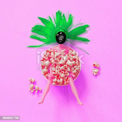 964258970 istock photo chocolate donut instead of a doll head in a plate of popcorn. 968882796