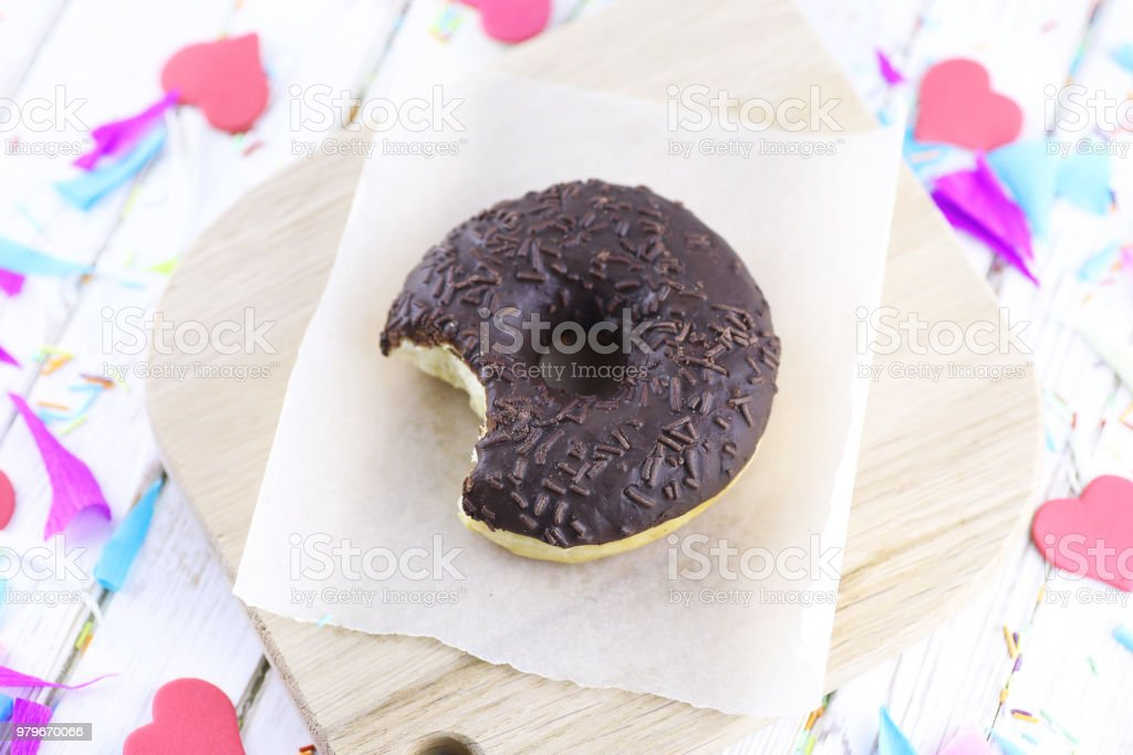 Chocolate Donut on a wooden white background stock photo