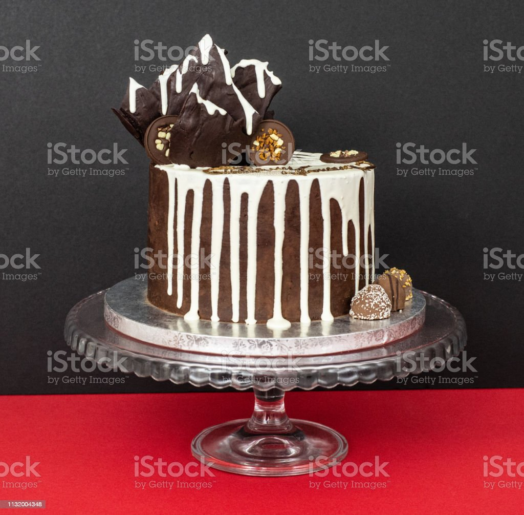 Fine Chocolate Drip Cake On Red And Black Background Stock Photo Funny Birthday Cards Online Bapapcheapnameinfo