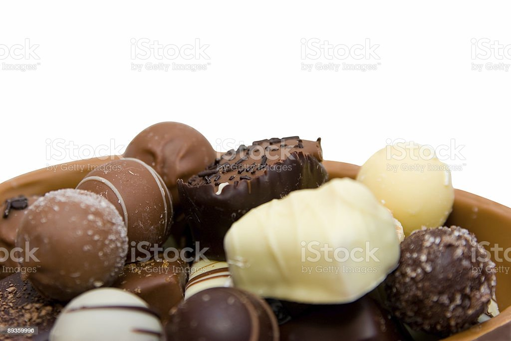 Chocolate easter egg with candy isolated on white (clipping path) royaltyfri bildbanksbilder
