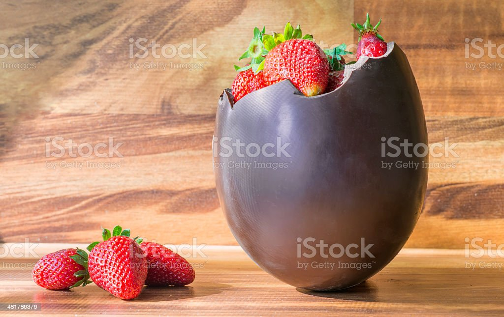 Chocolate Easter egg with the top broken stock photo