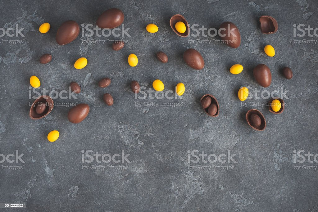 Chocolate easter eggs on dark background. Flat lay, top view stock photo