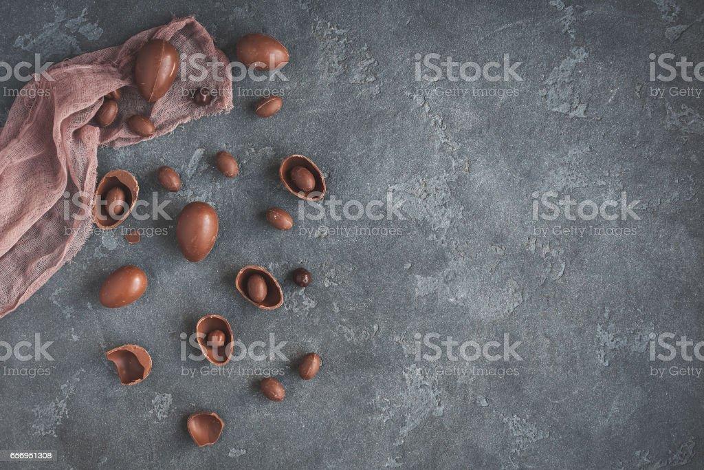 Chocolate easter eggs on dark background stock photo
