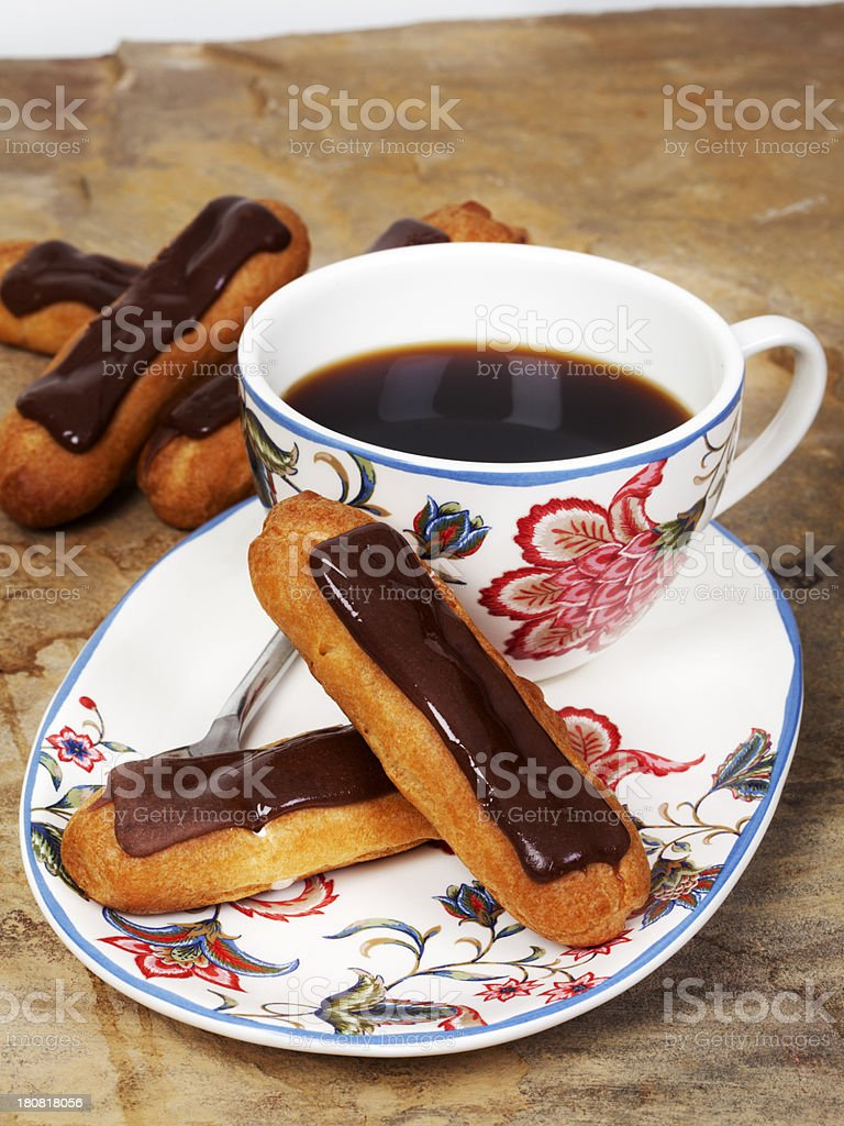 chocolate eclairs with coffee royalty-free stock photo