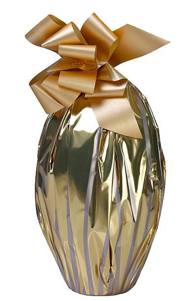 schokolade ei golden - eierverpackung stock-fotos und bilder