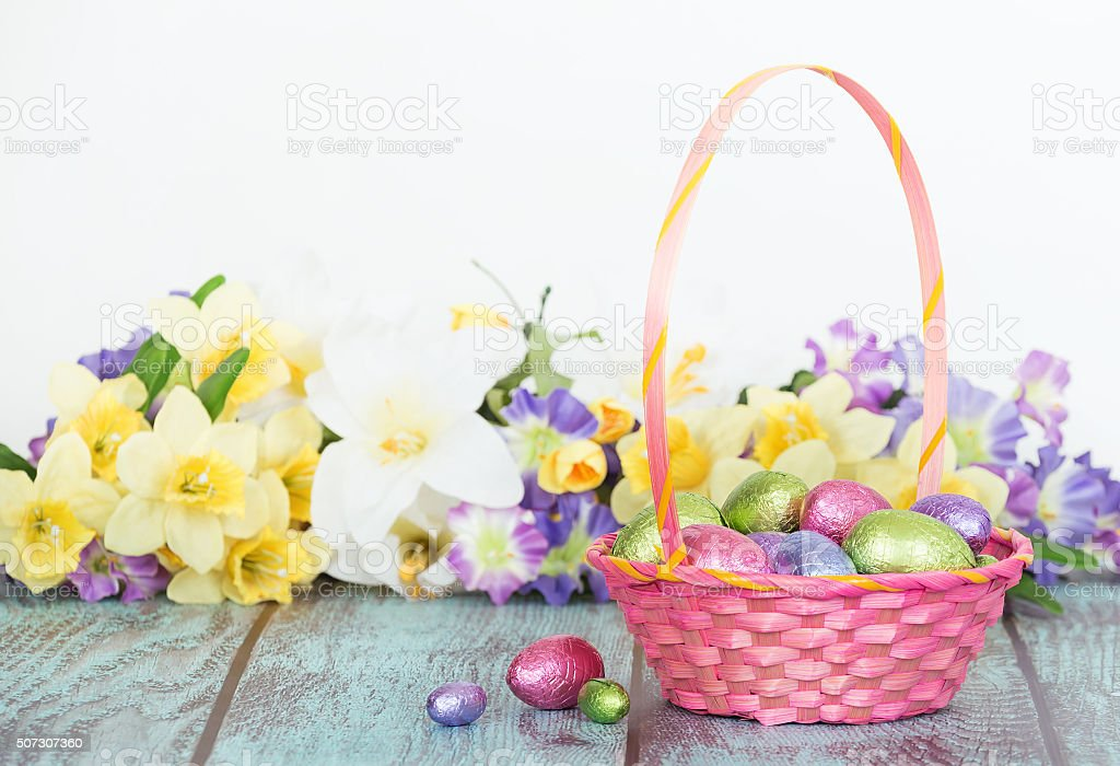 Chocolate eggs in a pink Easter basket stock photo