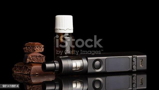 177005367 istock photo Chocolate, electronic cigarette liquid for Smoking isolated on black 931418814