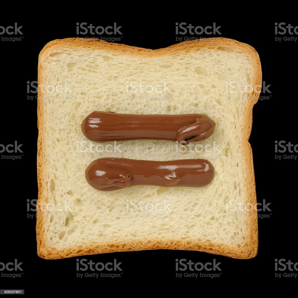 Chocolate equals sign on a tinloaf slice, black background stock photo