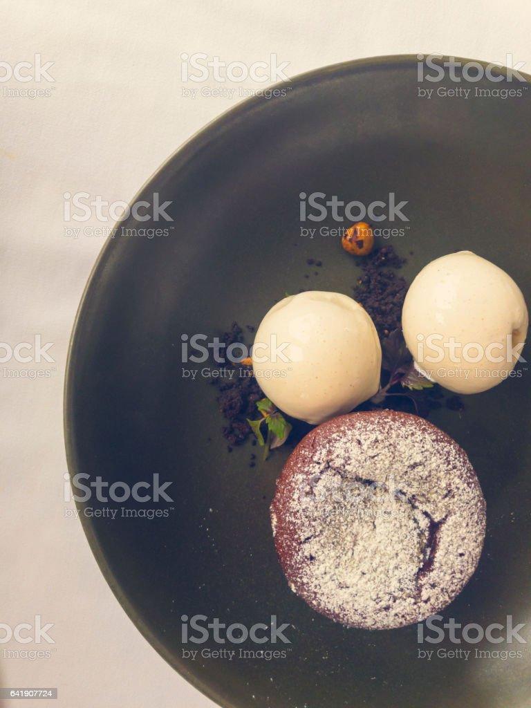 Chocolate fondant dessert in a bowl. stock photo