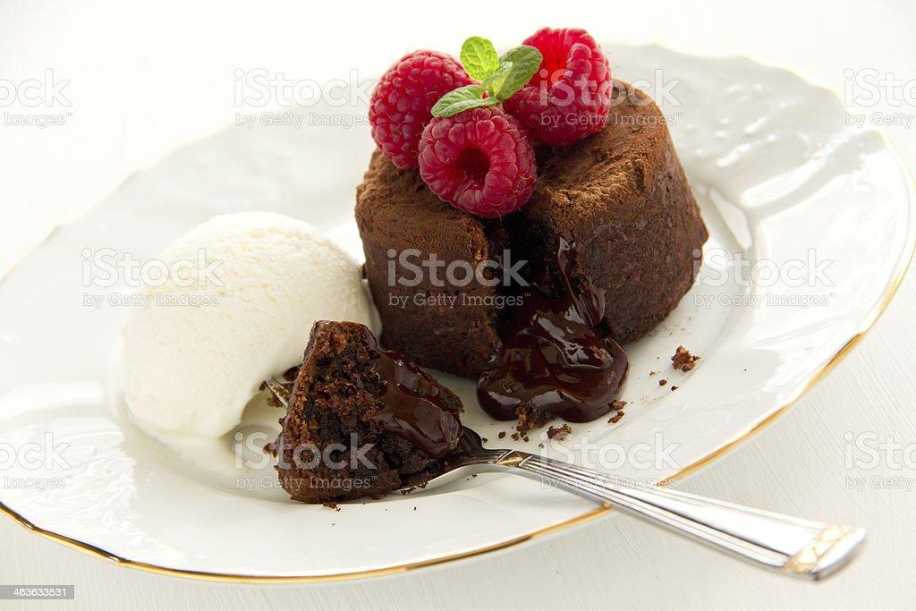Chocolate fondant (pudding) with raspberries. stock photo