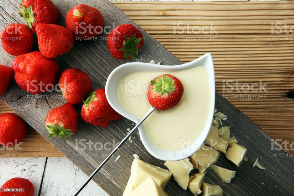 Chocolate fondue melted with fresh strawberries and white chocolate...