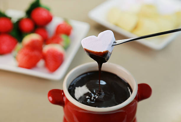 Chocolate fondue food chocolate fondue stock pictures, royalty-free photos & images
