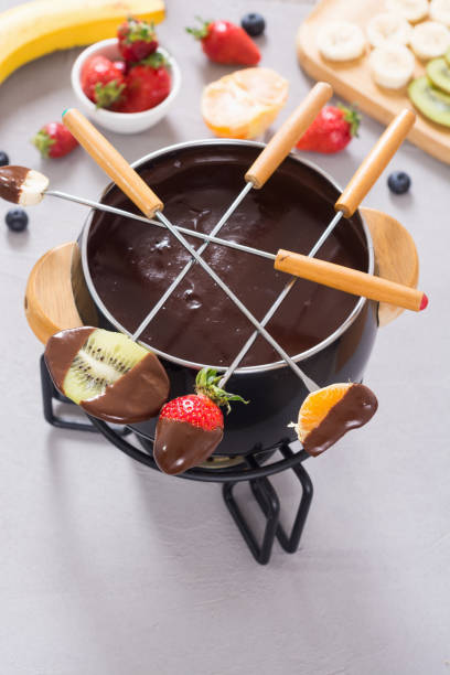 Chocolate fondue whith fruit and berries Dessert . Chocolate fondue whith fruit and berries . Food background chocolate fondue stock pictures, royalty-free photos & images