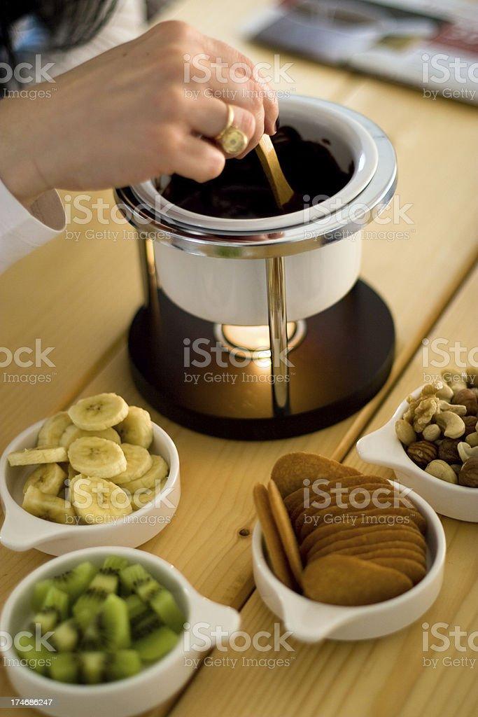 Chocolate fondue with fruit royalty-free stock photo