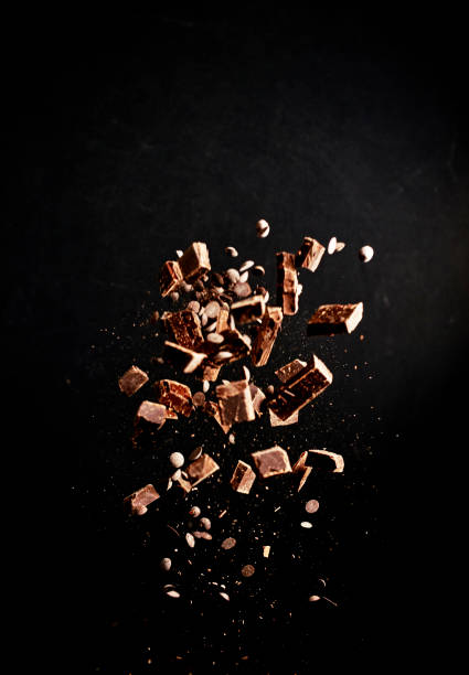 Chocolate Food Explosion with Cocoa Powder, Chocolate Chips and Nuts stock photo