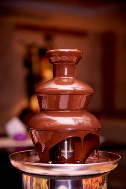 Chocolate fountain close up. Chocolate fountain close up. chocolate fondue stock pictures, royalty-free photos & images