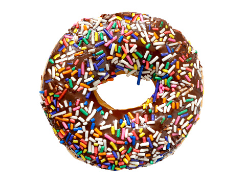 istock Chocolate frosted donut with colorful festive sprinkles 896241142