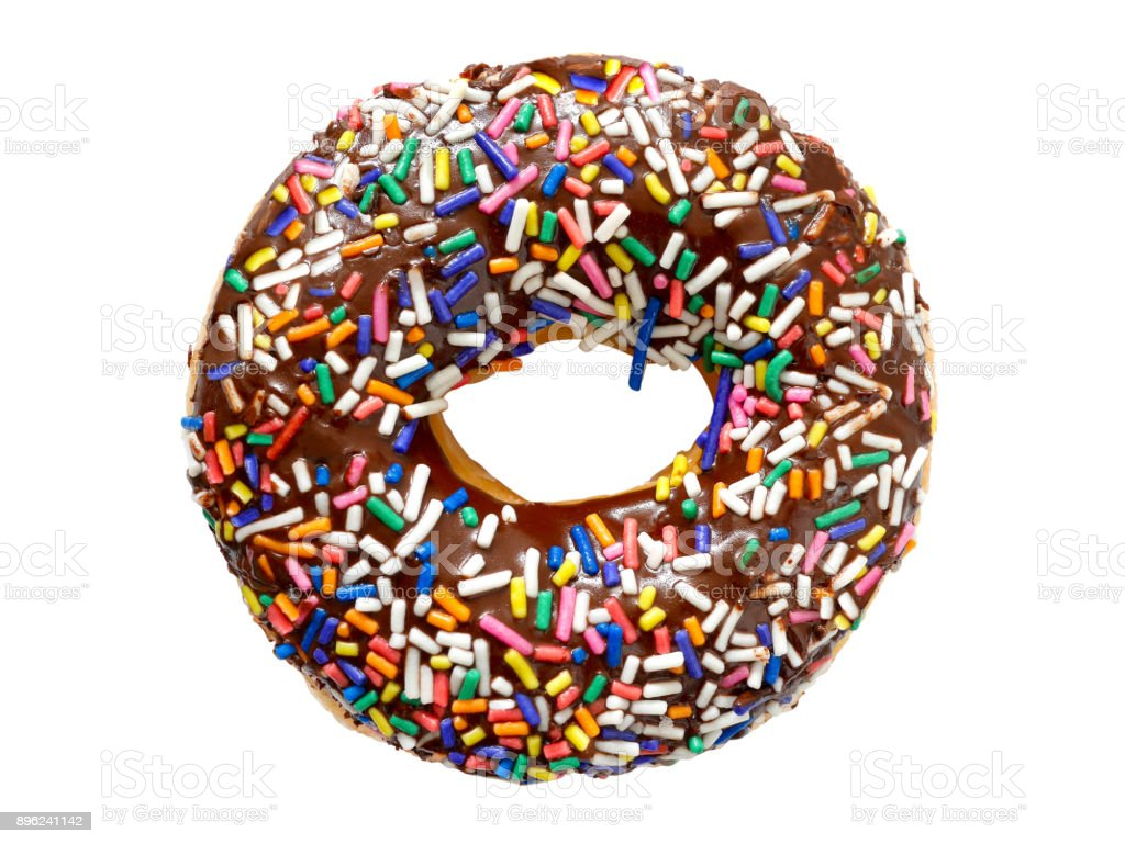 Chocolate frosted donut with colorful festive sprinkles stock photo