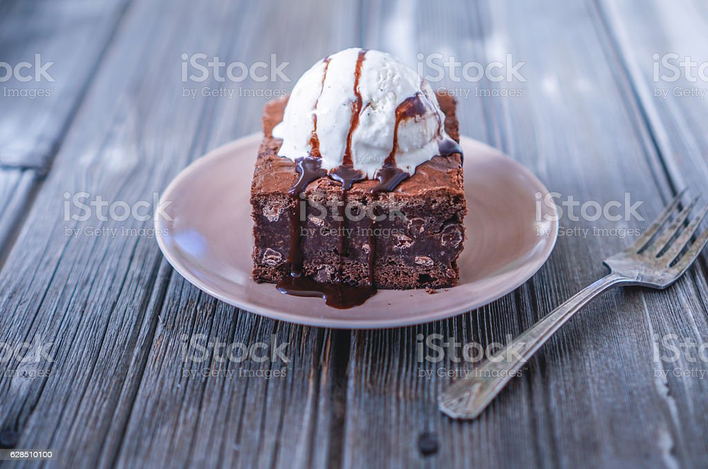 Chocolate Fudgy Brownie With Vanilla Ice Cream On Top Stock Photo More Pictures Of Addiction