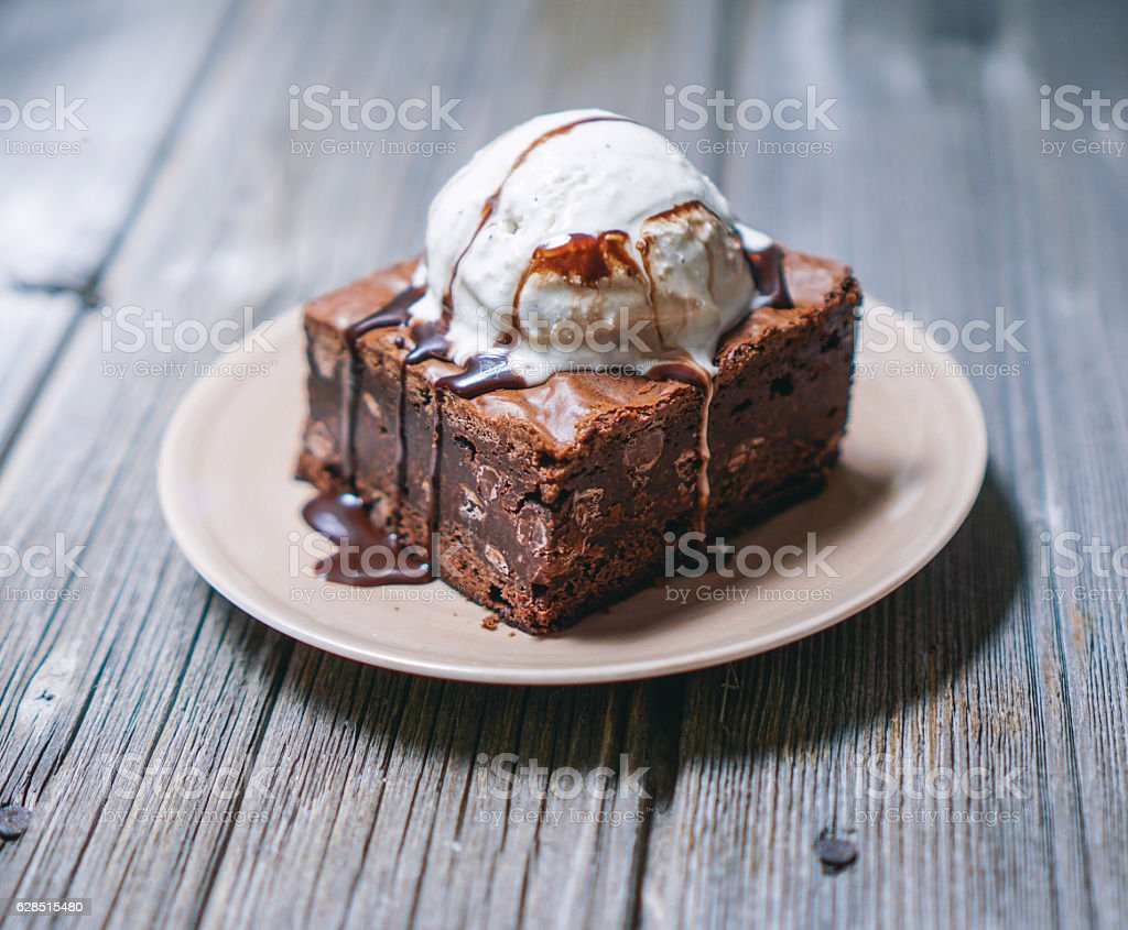 Chocolate Fudgy Brownie With Vanilla Ice Cream On Top Stock Photo