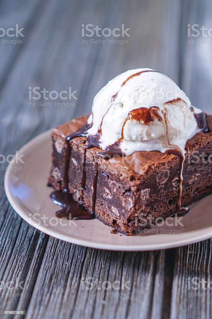 Chocolate Fudgy Brownie with Vanilla Ice Cream on top. stock photo