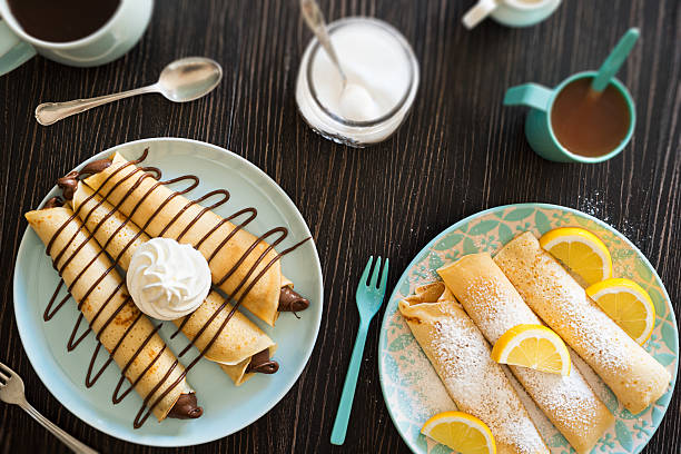 chocolate hazelnut spread and lemon powdered sugar crepes - crepe bildbanksfoton och bilder