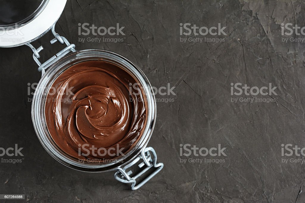 Chocolate hazelnut spread or nuts butter stock photo