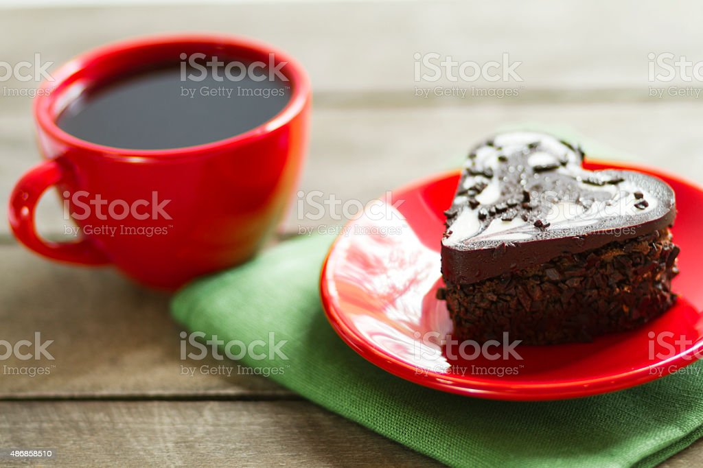 Chocolate Heart And Black Coffee Cake Royalty Free Stock Photo